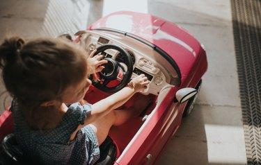 Child inside toy car
