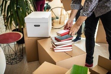 Pile of books on cardboard box