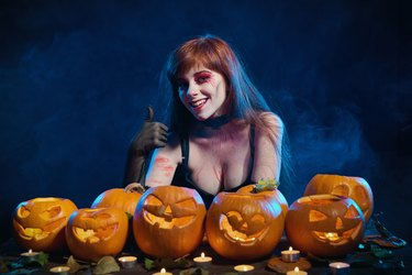 Woman with Halloween pumpkins