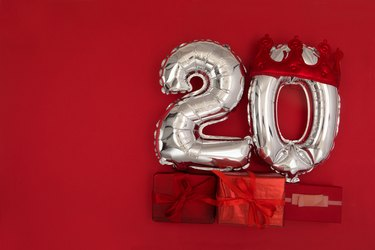 Foil balloons with number 20 on red background