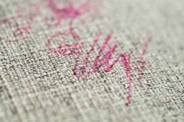 Painted fabric on sofa pink marker. Furniture fabric.