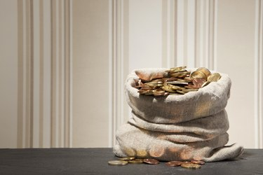 Large sack full of euro coins on a table