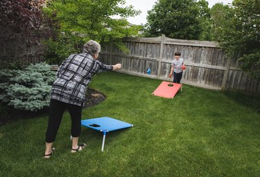 Family playing lawn games