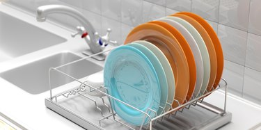 dish-drying rack with colorful plates