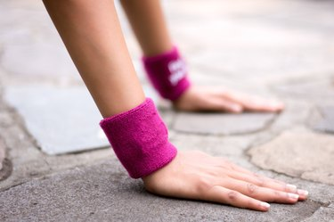 Woman With Wristbands Exercising