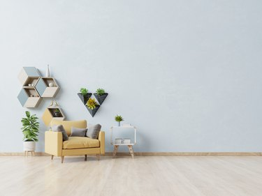 Potted Plant By Sofa Against White Wall At Home