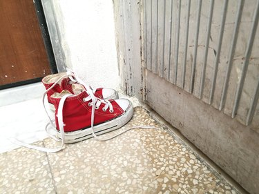 High Angle View Of Kids Converse Red Shoes On Floor