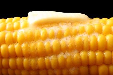 Butter slice melting on hot corn