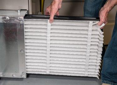 Man removing air filter