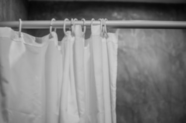 blurry photo of shower curtain black and white tone