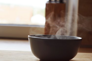 Hot steam rising from bowl