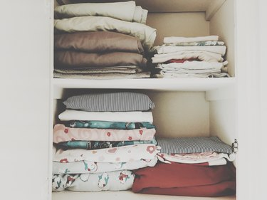 Blankets and sheets stacked on shelves