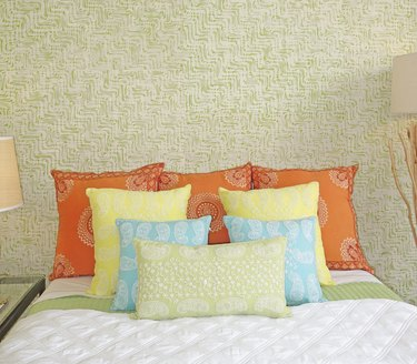 Embroidered pillows on bed