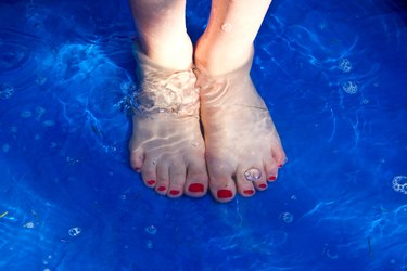 Girl with feet in pool