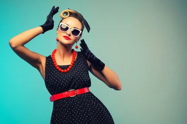 Funny retro portraits. Pin up woman dressing elegant for a special event. Beauty fashion model on colored backgrounds