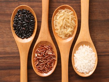 Different types of rice in spoons