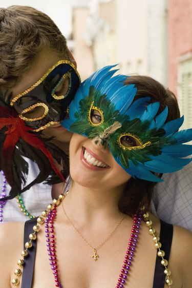 Intimate couple with masquerade masks