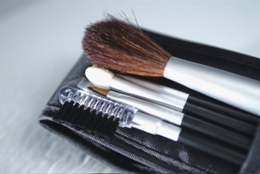High angle view of assorted make-up brushes