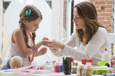 Mother and daughter doing crafts together