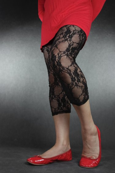 Woman  wearing black lace leggins and dress