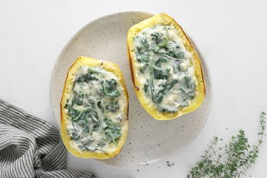 Add spinach filling to the squash
