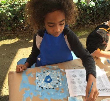Child painting a snowflake