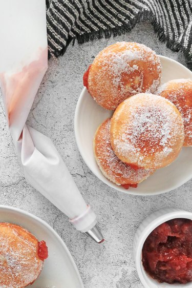 Squeeze jam or custard into the paczki