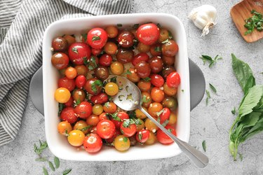 Toss tomatoes, olive oil, spices and herbs