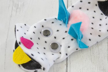 attach ears, eyes, nose, tongue and pom-pom with hot glue