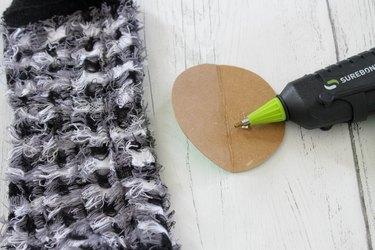 put hot glue on cardboard circle