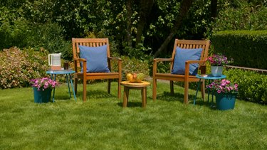 beautiful backyard with wooden chairs and flowers