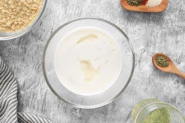 Combine milk and vinegar