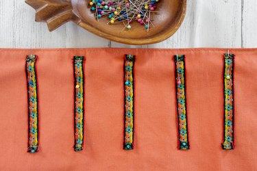 pin short ribbons to place mat