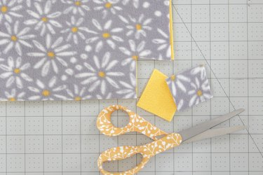 cut 2-inch squares from each corner
