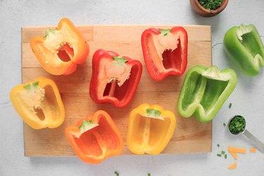 Cut bell peppers in half