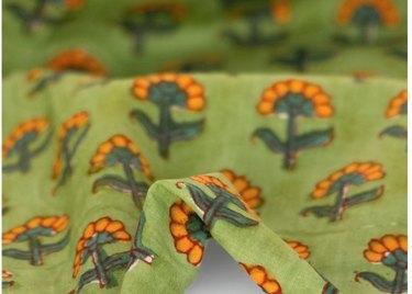 Orange flowers on green fabric