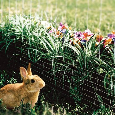You can build a wire compost bin quite easily with posts and fencing.