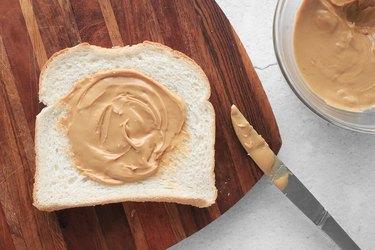 Spread nut butter on bread