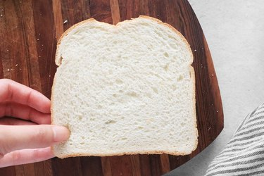 Place slice of bread on top