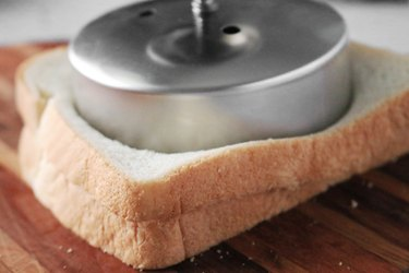 Press sandwich cutter into the bread