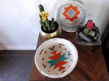 White, orange and teal woven basket.