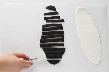 Slice black fondant into strips