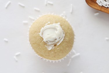 Spread frosting onto cupcake