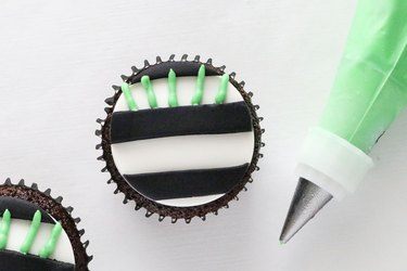 Add  bright green frosting