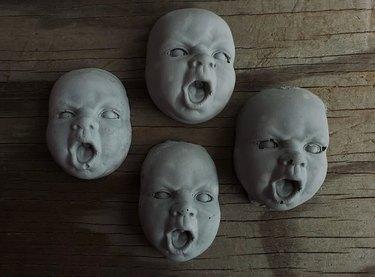 Creepy Wailing Child Cement Faces
