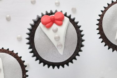Add button sprinkles and red bow