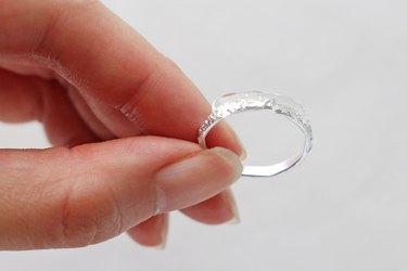 Add glue to a faux wedding ring
