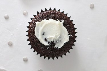Spread frosting onto the cupcake