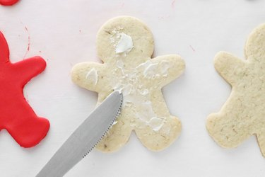 Spread icing onto each cookie