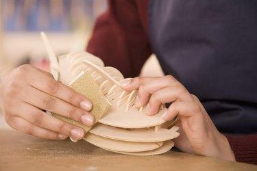 Student sanding craft project